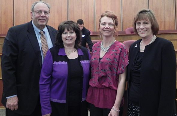 Pictured left to right: Oakland County Circuit Court Judge Edward Sosnick, President of Your Aging Well Advisor Lynn Alexander, Oakland County Commissioner Angela N. River and City of Auburn Hills Senior Service Director Karen S. Adcock, S.D.C., in the Oakland County Board of Commissioners' Auditorium, in Pontiac, Michigan.