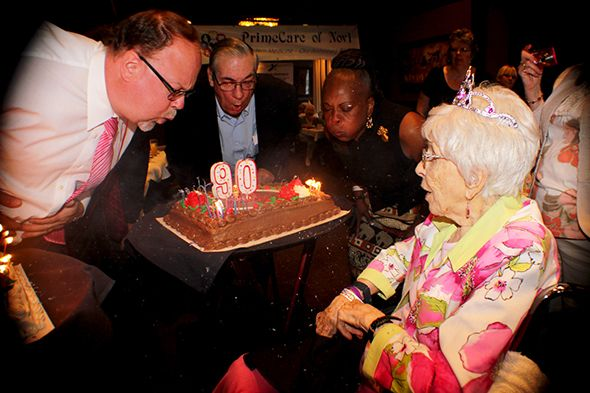 Pictured left to right are Oakland County Commissioner  Jim Runestad,  Walled Lake Mayor William T. Roberts and Oakland County Commissioner Mattie McKinney Hatchett with the oldest person at the 90 and Beyond Birthday  Celebration hosted by Affinity Health Care Agency, Inc.,  102-year-old Gwen Banghart.