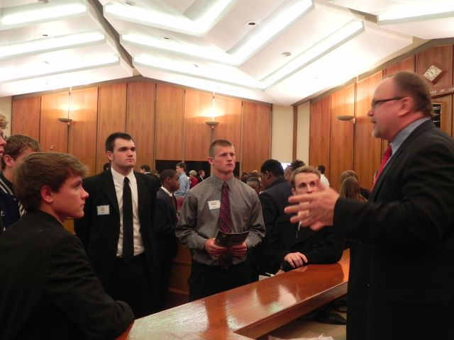 Commissioner Jim Runestad answers questions from students
