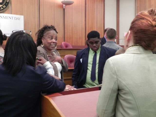 Commissioner Mattie Hatchett speaks with students
