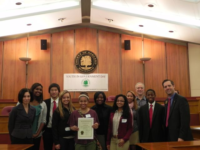 Commissioners Helaine Zack and Craig Covey with students from Ferndale High School