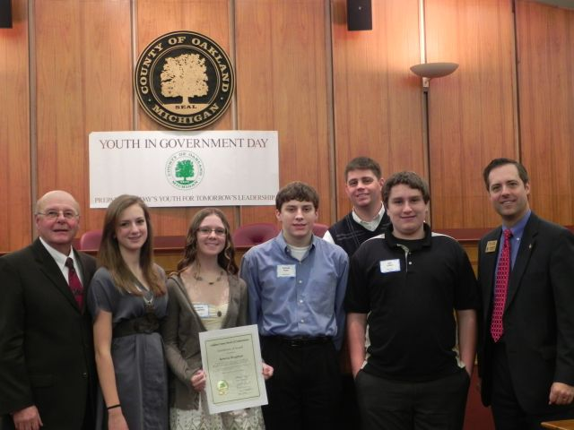 Commissioners Tom Middleton and Jeff Matis with students from Lake Orion High School