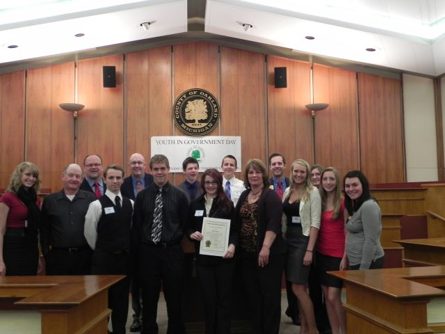 Commissioners Bob Hoffman, Jim Runestad and Christine Long with students from Lakeland High School