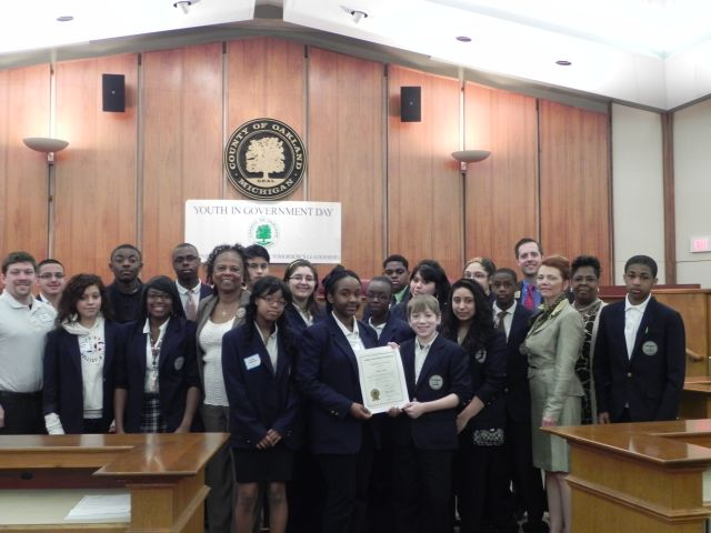 Commissioners Mattie Hatchett and Angela River with students from Pontiac International Tech Academy