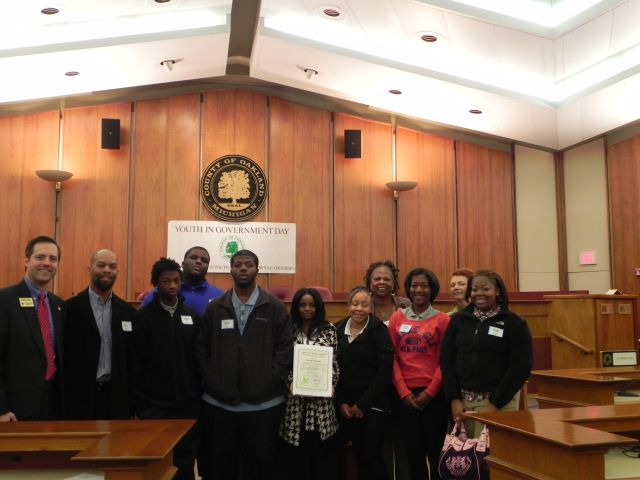 Commissioners Mattie Hatchett and Angela River with students from Pontiac High School