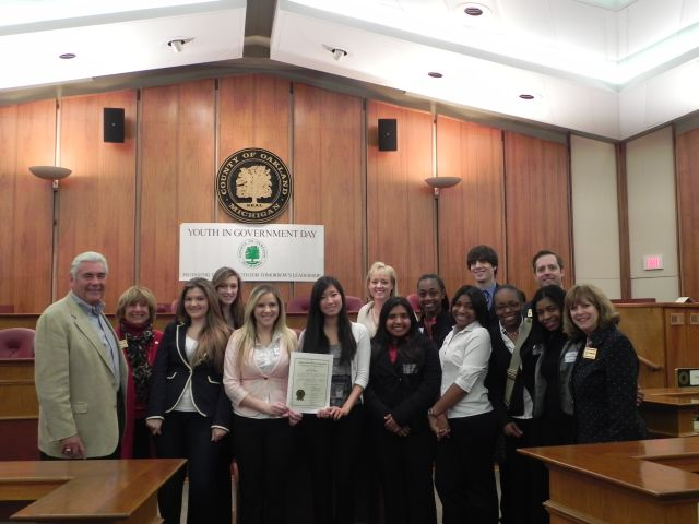 Commissioners John Scott, Shelley Taub and Marcia Gershenson with students from West Bloomfield High School