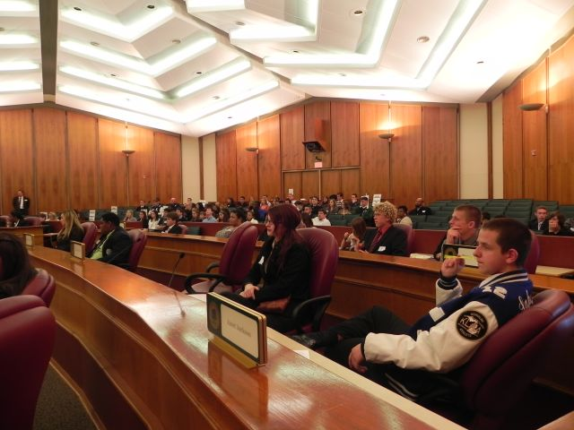Students listen to the Board Finance Committee meeting