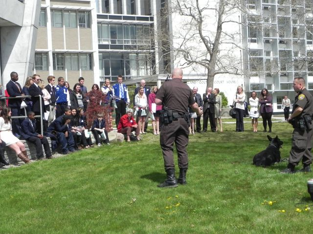 students watch a demonstration by the Oakland County Sheriff's Department K-9 Unit