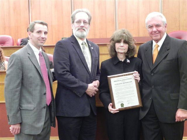Pictured left to right are: Oakland County Board Chairman Michael J. Gingell, Oakland County Commissioner Jim Nash, Estralee Michaelson, and Oakland County Commissioner Bill Dwyer.