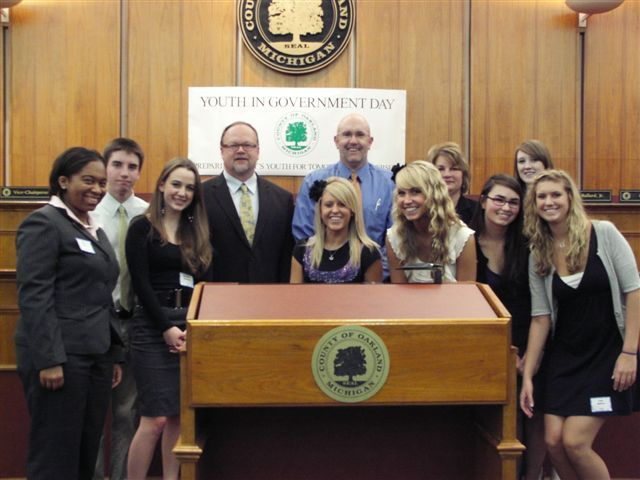 Commissioners Jim Runestad and Christine Long with students from the Milford area.