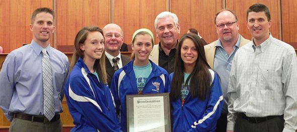 Members of the Waterford Our Lady of the Lakes Girls Basketball team and Oakland County Commissioners Tom Middleton, John Scott, and Jim Runestad.