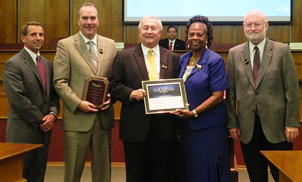 Pictured left to right:  Oakland County Chairman Michael J. Gingell,  Deputy  Executive/Chief Information Officer Phil Bertolini, Oakland County Executive L. Brooks Patterson, Oakland County Commissioner Mattie McKinney Hatchett and NAco representative, and Oakland County Chief Information Director Ed Poisson.