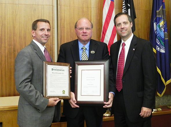Oakland County Board Chairman Michael J. Gingell, Oakland County Clerk/ Register of Deeds Bill Bullard Jr., and Oakland County Board Vice Chairman Jeff  Matis are shown with the awards Mr. Bullard and his staff received.
