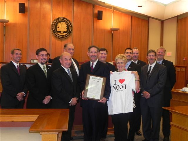 Commissioners Michael Gingell, Kathy Crawford, and Philip Weipert with Novi City Officials