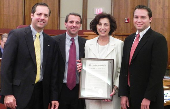 Oakland County Board Vice Chairman Jeff Matis, Oakland County Board Chairman Mike Gingell, Oakland County's Corporation Counsel Judy Cunningham and her son Jacob Cunningham