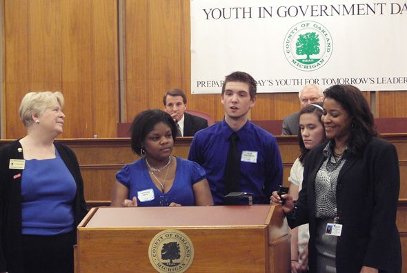 Commissioners Sue Ann Douglas, Janet Jackson, Mike Gingell with students