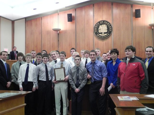 Commissioners Beth Nuccio, Michael Gingell and Jeff Matis with members of the Oxford High School Boys Wrestling team