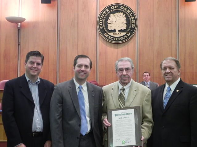 (pictured left to right) -- Mike Bosnic,  Board Vice Chairman Jeff Matis , Honoree Paul Carey and Commissioner Robert Gosselin