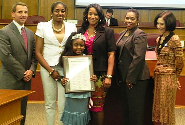 Pictured, left to right:  Oakland County Board Chairman Michael J. Gingell, Mrs. Odgra Williams, mother of Miss Michigan Princess Queen Kierra K. Williams (who is pictured holding the proclamation), along with Commissioners Nancy Quarles, Janet Jackson and Helaine Zack.