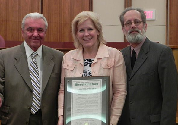 Shawne Duperon is pictured here with Commissioners Bill Dwyer (left) and Jim Nash