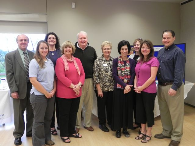 Back row: Alex Goldberg, Christina Travahara, Commissioners David Potts and Kathy Crawford, Roberta Habowski. Front row: Rachel Wilson, Commissioners Shelley Taub and Helaine Zack, and Tina Abbott.