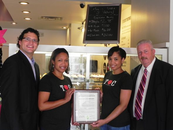Pictured left to right, in Royal Oak: Oakland County Commissioner David Woodward, Taste of Love owners and operators Yolanda Baston and Michelle Brown (holding the proclamation), and Oakland County Commissioner Gary McGillivray.