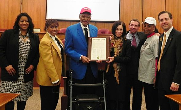 Pictured left to right: Oakland County Commissioners Janet Jackson and Nancy Quarles, Tuskegee Airman Staff Sergeant Sandy Reid, Oakland County Commissoner Helaine Zack, Board Chairman Michael J. Gingell, Commissioner Mattie McKinney Hatchett and Board Vice Chairman Jeff Matis.