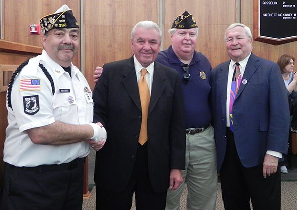 Frank Flores, Commissioner Bill Dwyer; a veteran and acquaintance of Commissioner Dwyer; and Oakland County Executive L. Brooks Patterson.