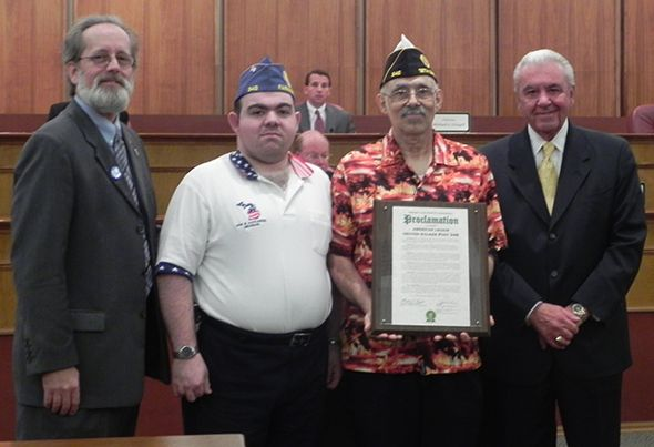 Pictured, left to right, are Commissioner Jim Nash - an Army veteran, Chris Mallia and his father - Junior Vice Commander Anthony Mallia; and Oakland County Commissioner Bill Dwyer.