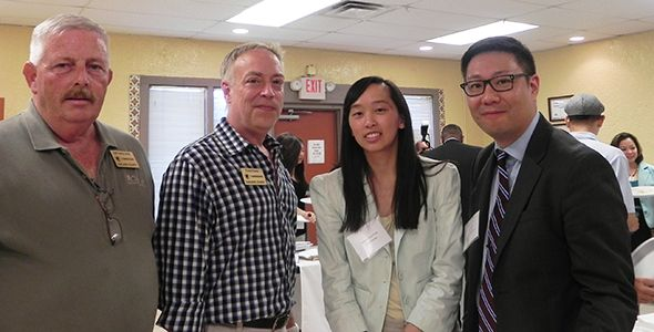 Commissioners Gary McGillivray (left) and Craig Covey, Stephanie Gray Chang of APIA Vote Michigan, and Tom Hayashi, Executive Director of the Organization for Chinese Americans