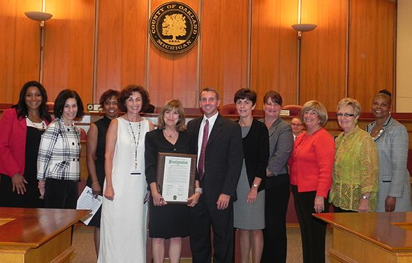 Picture from left to right are:  Commissioners Janet Jackson, Helaine Zack, and Nancy Quarles; Corporation Counsel Judy Cunningham; Commissioners Marcia Gershenson and Board Chairman Michael Gingell; and Commissioners Beth Nuccio, Christing Long, Shelley Goodman Taub, Kathy Crawford and Mattie McKinney Hatchett.