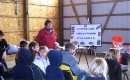 Master Gardener volunteers teach children on various subject areas.