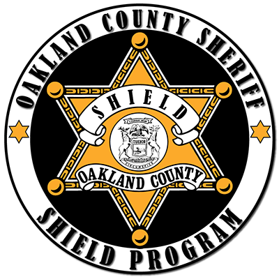 Sheriff's Shield Logo: Golden sheriff's star inside black circle